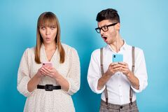 Free Photo Of Shocked Upset Young Couple Wear White Outfit Reading Modern Gadgets Isolated Blue Color Background Royalty Free Stock Photography - 214810427