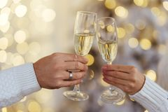 Free Photo Of Two People Holding Glasses Of Shampagne On Xmas Stock Photo - 165049550
