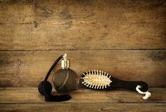 Free Photo Of Vintage Perfume Bottle Next To Old Wooden Hairbrush On Wooden Table. Retro Filtered Image Stock Photos - 58971803