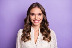 Free Photo Of Young Beautiful Charming Positive Smiling Girl With Wavy Hear Wear White Blouse  On Purple Color Royalty Free Stock Photography - 212074917