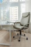 Photo of office leather chair behind white working table Royalty Free Stock Images