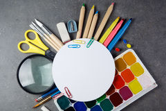 Photo of office and student gear over white background Royalty Free Stock Images