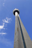 Photo og the CN Tower, blue sky, clouds and the plane Royalty Free Stock Image