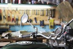 Green modern motorcycle in the garage. Photo og green modern motorcycle in the garage stock images