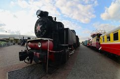 Photo of old black steam locomotives of the Soviet Union. Strong distortion from the fisheye len. S royalty free stock photos