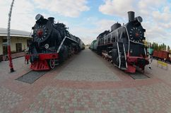 Photo of old black steam locomotives of the Soviet Union. Strong distortion from the fisheye len. S royalty free stock photography