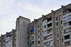 Old multi-storey apartment house in a poorly-developed region of. Photo of an old brick multi-storey apartment house in a poorly-developed region of Ukraine or royalty free stock photos
