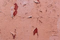 Photo of an old cracked brown paint. On wall Stock Photo