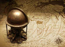 Old globe on map of the world Stock Image