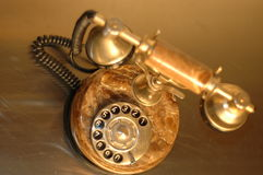 Photo old gold telephone Stock Photos