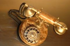Photo old gold telephone. Old gold telephone,Telecommunication,Media Technologies Stock Photos
