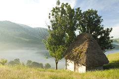 Photo of old house in the mountains in the sunrise Stock Images