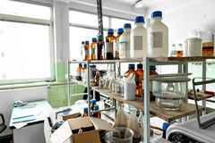 Photo of an old laboratory with a lot of bottles Stock Photography