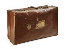 Vintage leather luggage over white background. Photo of an old leather suitcase. Isolated with clipping path included stock photo