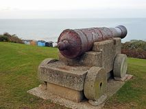 Old rusty war canon on coastline Royalty Free Stock Photography
