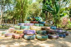 Photo of old tyre, paint and reuse in the park.  Royalty Free Stock Photos
