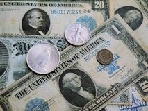 Old American banknotes and coins. Royalty Free Stock Photography