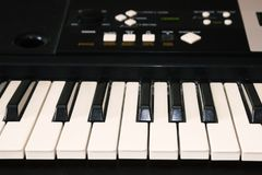 A photo of old used synthesizer, electronic musical keyboard. Keyboard or piano for digital music recording, a music instrument ba Royalty Free Stock Photo