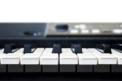 A photo of old used synthesizer, electronic musical keyboard or piano for digital music recording, a music instrument background, Royalty Free Stock Image