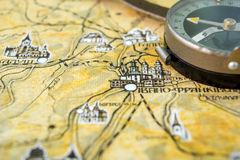 Photo of old vintage map on aged page with compass Stock Photography