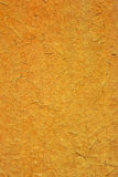 Photo of an old wooden board texture consist of wood sawdust. Photo of an old orange wooden board texture consist of wood sawdust Royalty Free Stock Photography