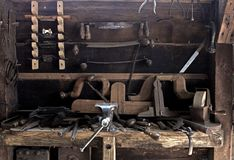 Old work place for craftmanship. Photo of an old work place for craftmanship and tools to create wooden things stock images