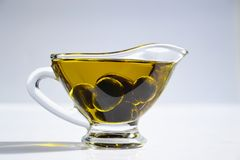 Photo of Olives on Cup of Olive Oil Royalty Free Stock Images