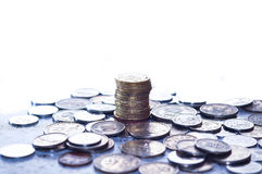 Photo of one stacking coin or penny. Gold coins stack on the table Royalty Free Stock Photo