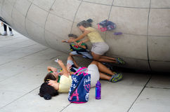 Photo op at the cloud gate. A mom and her son pose for a photo almost under the famous sculpture called 'cloud gate' although most refer to it as &#x27 royalty free stock photography