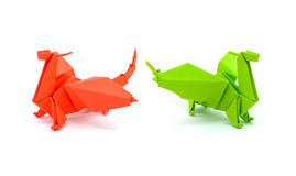 Photo of origami green and red dragons isolated on white background Stock Image