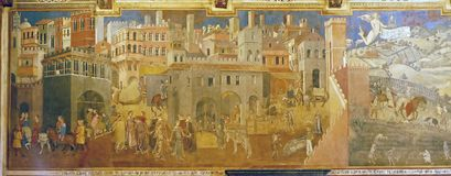 Photo of the original fresco `Effect of Good Government on City and Countr` by Ambrogio Lorenzetti. stock photography