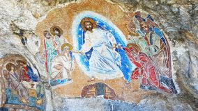 Orthodox mural in a cave stock image
