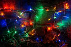 Outdoor Christmas Lights at Night. Photo of outdoor christmas light display at night. during december against a stone wall Stock Images
