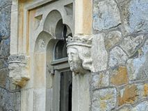 Gargoyles gargoyle heads faces grotesque window fort church castle royalty free stock photo
