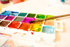 Photo of palette with watercolors and brush Royalty Free Stock Images