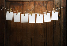 Photo paper attach to rope with clothes pins Stock Photography