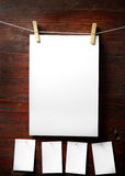 Photo paper attach to rope with clothes pins Royalty Free Stock Photo