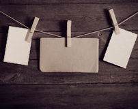 Photo paper attach to rope with clothes pins Royalty Free Stock Photography