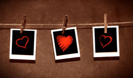 Photo paper with hearts attached to rope