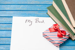 Photo of paper My book, pile of books and cute gift on the wonde Royalty Free Stock Photo