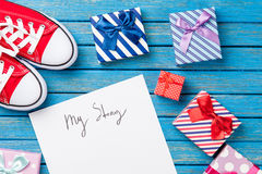 Photo of paper My story, gumshoes and cute gifts on the wonderfu Royalty Free Stock Images