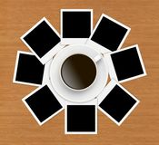 Photo papers and coffee cup on wooden Royalty Free Stock Image