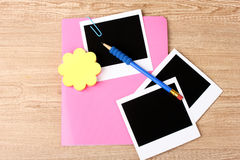 Photo papers and pink notebook Stock Image