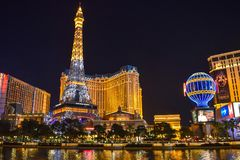 Las Vegas Skyline and Paris Hotel & Casino Illuminated royalty free stock image