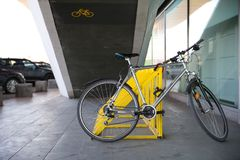 Photo of parked bicycle under the stairs for graphic and web design, for website or mobile app. Photo of parked bicycle under the stairs for graphic and web royalty free stock photos