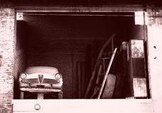 Car in the attic. In this photo the particularity is given by finding in this warehouse, which has been abandoned for years and placed on the first floor with Royalty Free Stock Photos