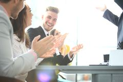 Photo of partners clapping hands after business seminar. Professional education, work meeting, presentation or coaching. Concept.Horizontal,blurred background royalty free stock image