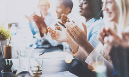 Photo of partners clapping hands after business seminar. Professional education, work meeting, presentation or coaching. Concept.Horizontal,blurred background