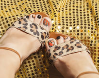 Photo of pedicure like butterfly design on gold Royalty Free Stock Photography