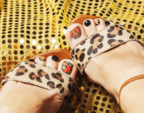 Photo of pedicure like butterfly design on gold background close Royalty Free Stock Photos